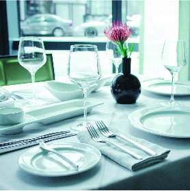 Table setting with glasses, plates and cutlery