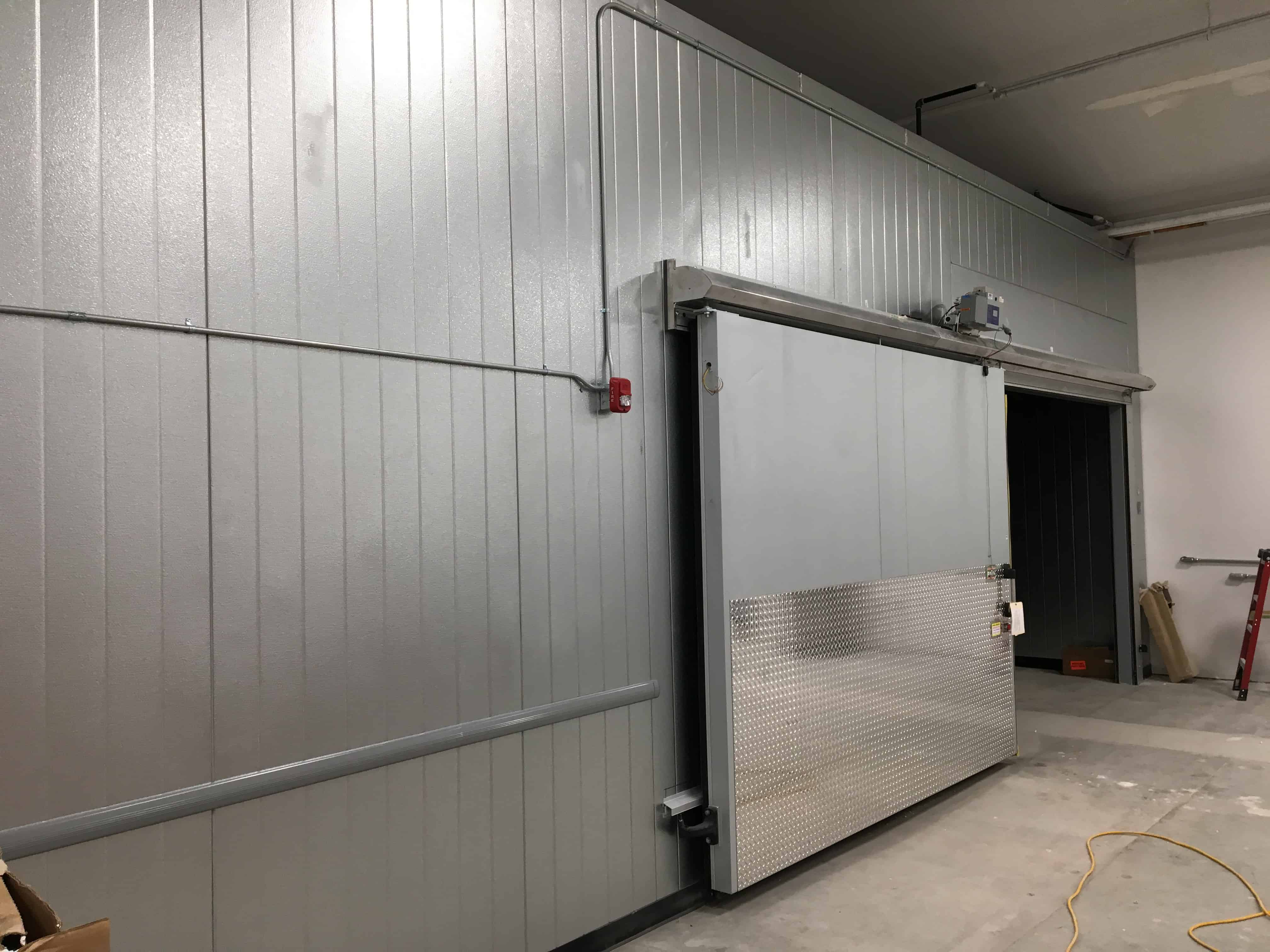 Commercial freezer with sliding door